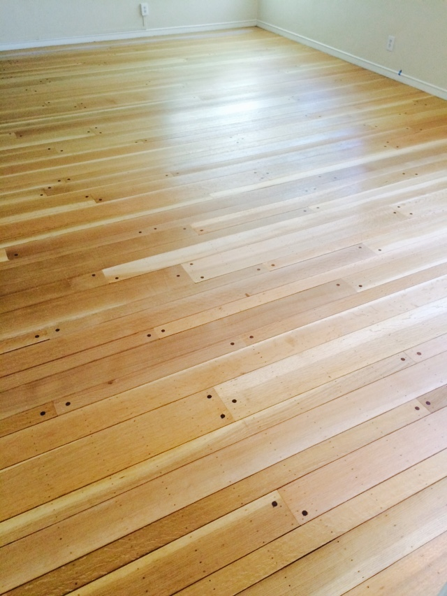 This 80 year old floor was repaired and refinished by Avi's Hardwood Floors